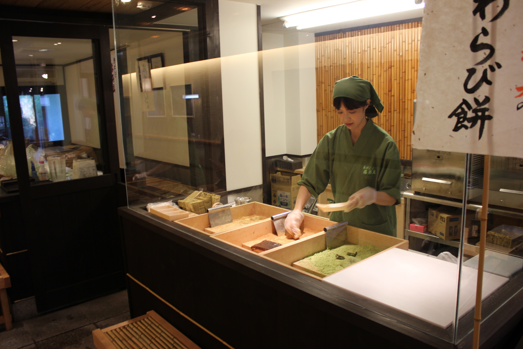 A Japanese chef making fresh dough for green tea dango
