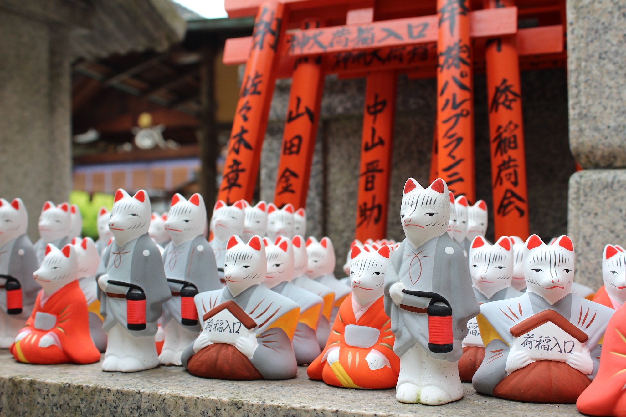 A group of fox figurines at Inari Jinja
